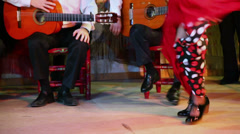Legs of woman which dances in flamenco style at small stage Stock Footage