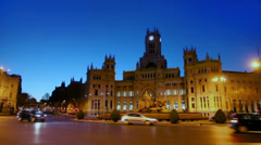 Traffic at Cibeles Square near old post office building at night Stock Footage