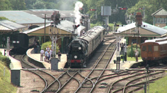 Vintage Steam Railway Station with Steam Trains Stock Footage