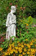 goddess statue in garden - stock photo