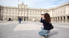 Woman makes photo of Palace of Spanish kings in Madrid, Spain. Stock Footage