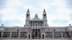 People walk near Cathedral of Nuestra Senora de la Almudena Stock Footage
