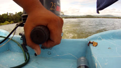 Lake Nicaragua boat rear hand on throttle Stock Footage