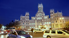 Transport moves by Cibeles Square near old post office building Stock Footage