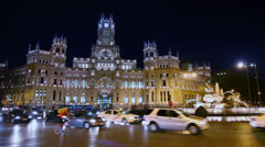 Traffic at Cibeles Square near old post office building Stock Footage