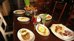 Meals and beverages served at table in cozy restaurant Stock Footage