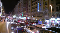 Cars and people at Gran Via street at night in Madrid Stock Footage