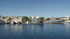 Military naval base and military ships moored Stock Footage