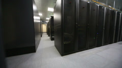 Room of data center with telecommunication racks and cables - stock footage