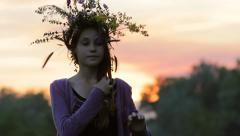 Silhouette Teenage Girl Wearing Flower Wreath on Nature at Sunset HD - stock footage