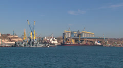 View of the port infrastructure and berths with ships from the sea Stock Footage