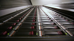 Lamps blink in data server with multiple hard drives at big rack - stock footage