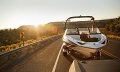 Boat outing. Driving a boat during a summer sunset. - stock photo