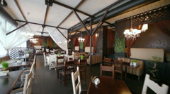 Motion through empty cozy restaurant with interesting design Stock Footage