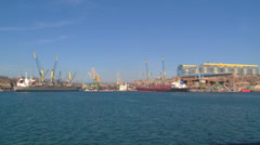 view of the port infrastructure and berths with ships from the sea - stock footage