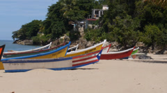 caribbean fishing boats in beautiful sandy beach-Crash Boat Beach-Aguadilla-Puer - stock footage