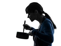Woman cooking mixing saucepan silhouette Stock Photos