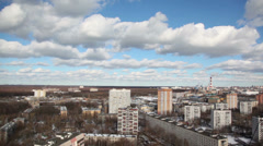 A daytime blue sky and roofs of apartment buildings (further) Stock Footage