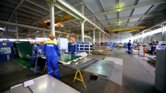 Workers in manufacturing workshop at plant - stock footage