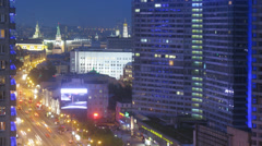 City traffic in the evening on New Arbat with Kremlin Stock Footage