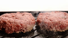 Burgers cooking on indoor grill Stock Footage
