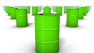 Stock Video Footage of Dolly over many Oil Drums to a single Drum (Green)