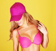 young woman dancing in a pink bikini - stock photo