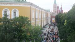 School graduates walking on alley near building, timelapse Stock Footage