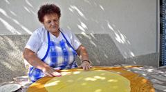 Grandmother rolls dough Stock Footage