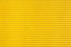 Yellow plastic holey background Stock Photos