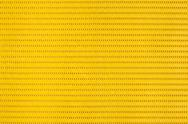 Stock Photo of yellow plastic holey background