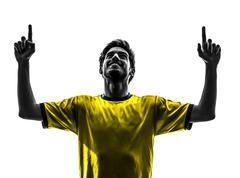 Brazilian soccer football player young happiness joy man silhouette Stock Photos