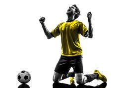 Brazilian soccer football player young happiness joy kneeling man silhouette Stock Photos