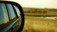 Stock Video Footage of rearview side mirror while driving by lake and highway rack focus