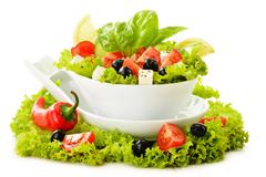 Stock Photo of vegetable salad bowl isolated on white