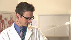 Doctor checking pulse of Teddy bear tilt shot Stock Footage