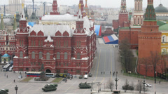 Military vehicles moving in front of History Museum at Kremlin Stock Footage