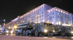 Military vehicles aligned for parade at night in Moscow Stock Footage