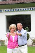 Senior couple giving a thumbs up gesture Stock Photos