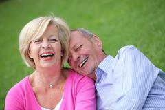 happy elderly couple laughing together - stock photo
