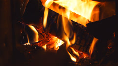 Adding firewood in furnace - stock footage