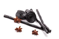 licorice candy and star anise - stock photo