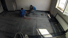Workers put new floor in a room of an apartment, timelapse Stock Footage
