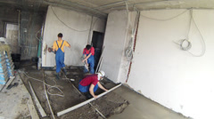 Workers fixing the level of new floor in the apartment Stock Footage