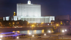 Night view of illuminated building on Moscow river embankment Stock Footage