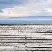 wood flooring on shore of dead sea - stock photo