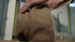 preparing clay 2 - stock footage