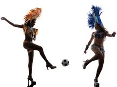 Women samba dancer playing soccer silhouette Stock Photos