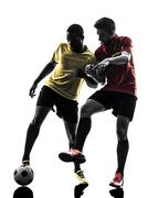Stock Photo of two men soccer player  standing silhouette