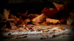 Drug addict's discarded needle (20) Stock Footage